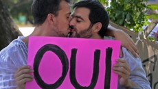France's lower house National Assembly adopted a bill legalising same-sex marriages and adoptions for gay...