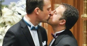 gay grooms kiss