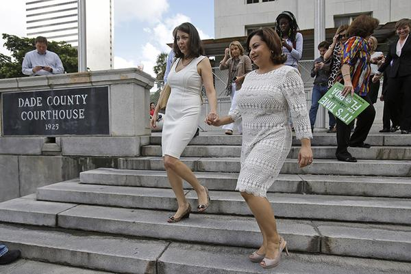 Cathy Pareto & Karla Arguello. the first same-sex couple to be officially married in Florida!